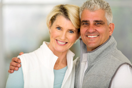 mid age: happy mid age couple standing at home