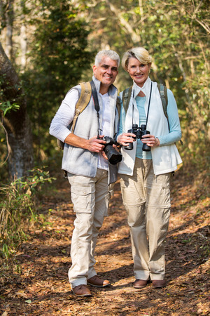 tourists: beautiful old couple standing in the forest Stock Photo