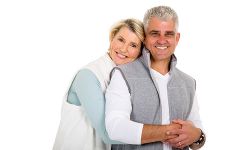 middle adult: pretty middle aged woman hugging her husband Stock Photo