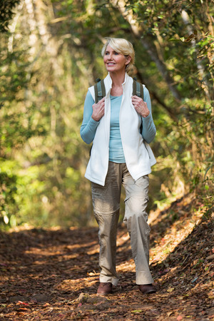 attractive middle aged woman hiking in mountain Banco de Imagens
