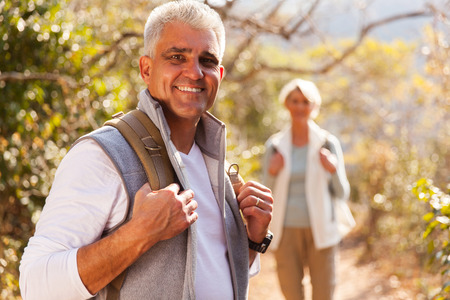 middle age: handsome senior man hiking with wife