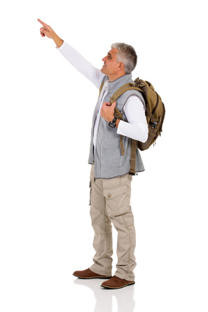 space age: handsome mid age tourist pointing copy space on white background Stock Photo