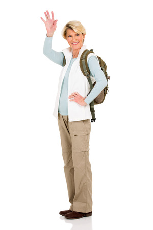 wave: happy middle aged female tourist waving goodbye Stock Photo