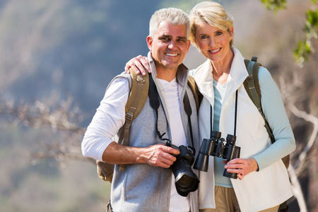 middle aged couple: portrait of middle aged couple hugging in mountain