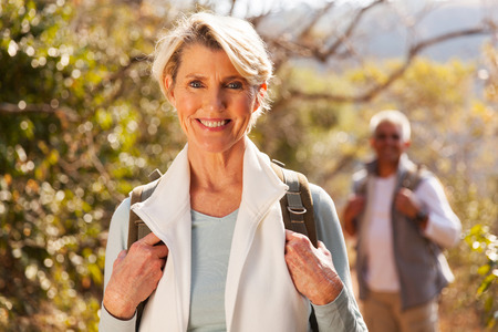 beautiful senior woman hiking in the mountain with husband Stock Photo