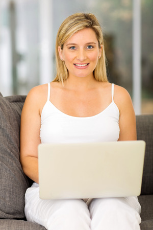 attractive pregnant: attractive pregnant woman with laptop computer at home