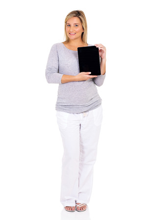 Caucasian woman: happy pregnant woman presenting tablet computer Stock Photo