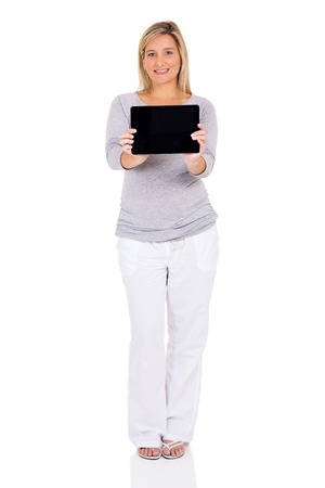 computer isolated: pretty pregnant woman showing tablet computer isolated on white background