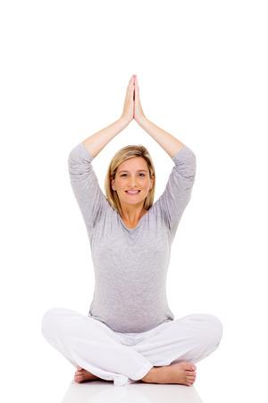 pregnant woman yoga: happy pregnant woman yoga meditating over white background Stock Photo