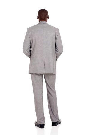 rear view of african businessman isolated on white background Foto de archivo
