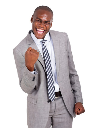 african business man: cheerful african business man holding fists on white background