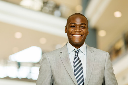 african business man: portrait of cheerful african business man in modern office