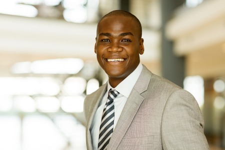 suit man: close up portrait of male african american corporate worker