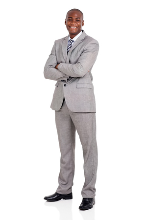 isolated  on white: handsome young african american businessman with arms folded