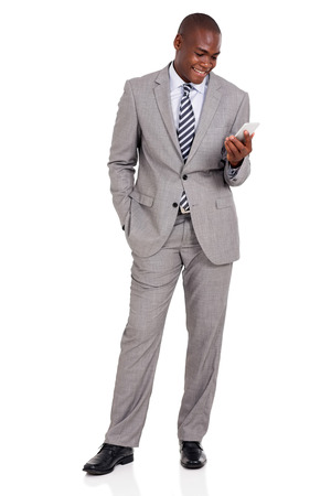 business men: happy african businessman holding cell phone on white background Stock Photo