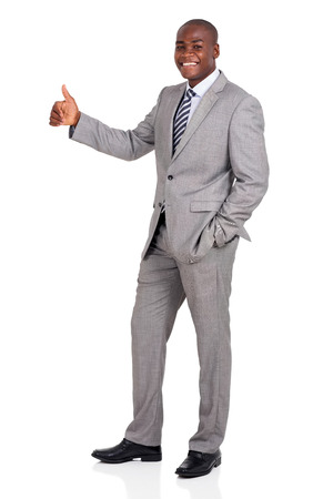 black male: side view of happy young african business executive giving thumb up