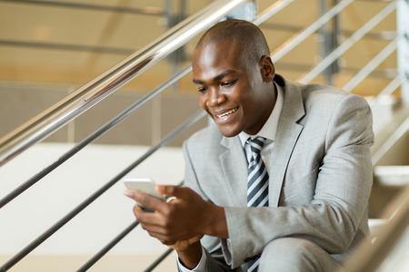 employees: modern black businessman using smart phone Stock Photo