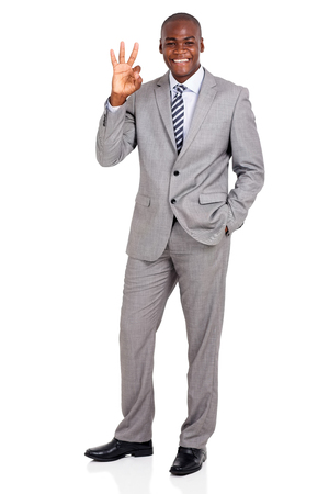 hand sign: happy afro american businessman giving ok hand sign