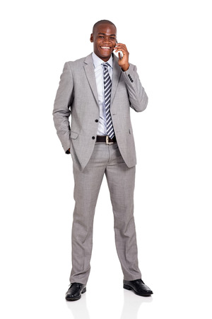 african business man: cheerful african american business man talking on cell phone