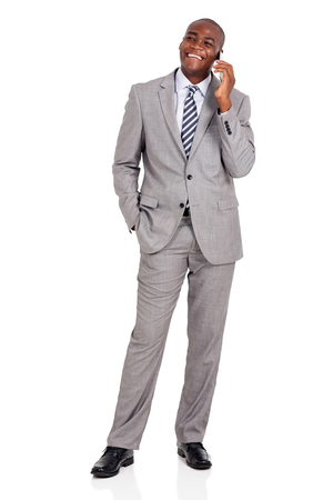 background person: happy african businessman talking on mobile phone isolated on white