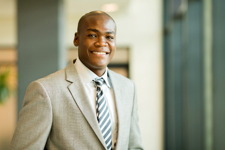 black guy: closeup portrait of young african american businessman in office Stock Photo