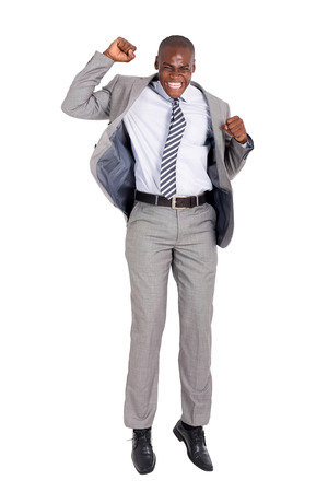 excited young african american businessman jumping on white background