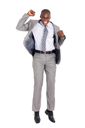 negras africanas: emocionado joven afroamericano hombre de negocios que salta en el fondo blanco Foto de archivo