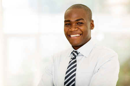 handsome african american businessman looking at the camera