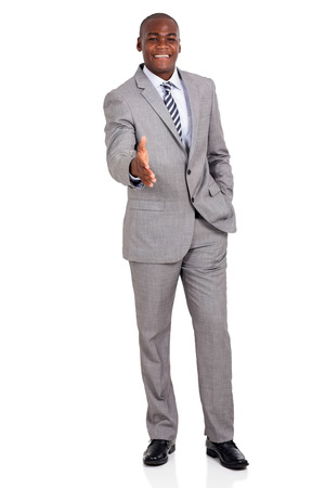 african american handshake: friendly african american businessman ready to handshake isolated on white background Stock Photo