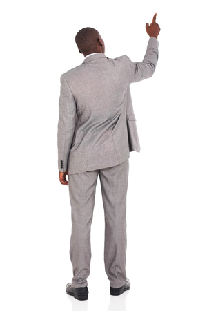 rear view of african american businessman pointing at empty space
