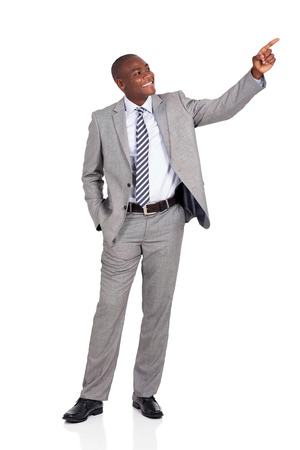 african businessman: cheerful african businessman pointing at empty copy space