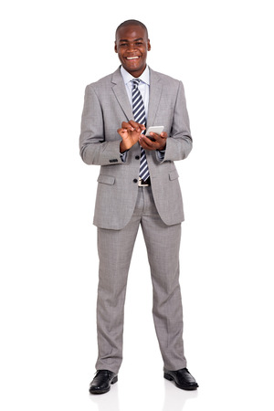 cheerful young african american businessman using cell phone