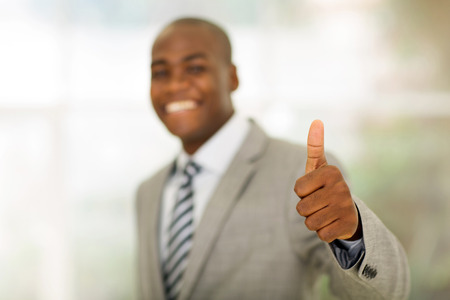 african business man: african business man giving thumb up