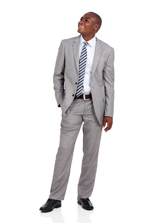 african business man: cheerful african american businessman looking up on white background