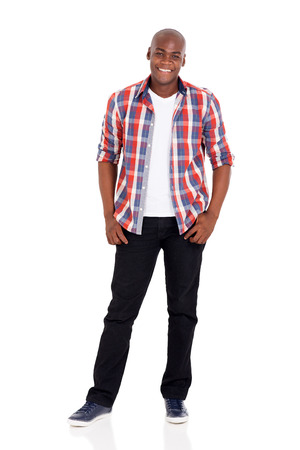 modelos negras: cheerful young african american man posing on white Foto de archivo