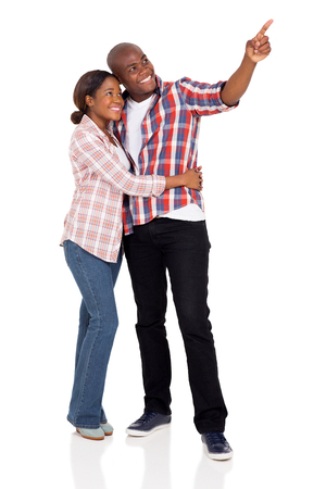 black male: lovely african american couple pointing on white background