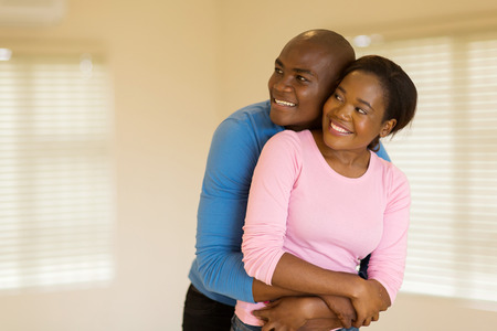 black couple: beautiful african husband and wife looking at their new apartment Stock Photo