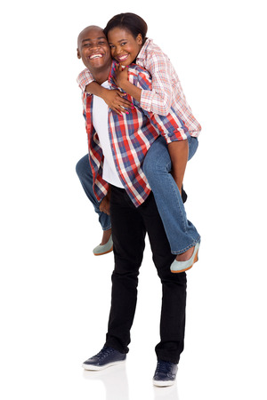 african american couple: cheerful young african american couple having fun with piggyback Stock Photo