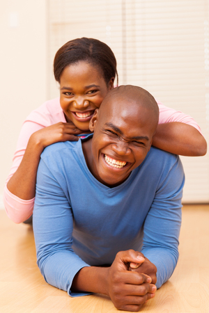 young black girl: cheerful young african couple in their first new house