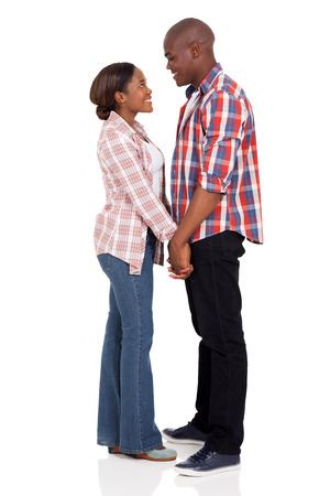 black hands: loving african american couple holding hands on white background Stock Photo