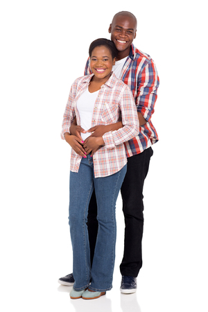 lovely young african couple hugging isolated on white background