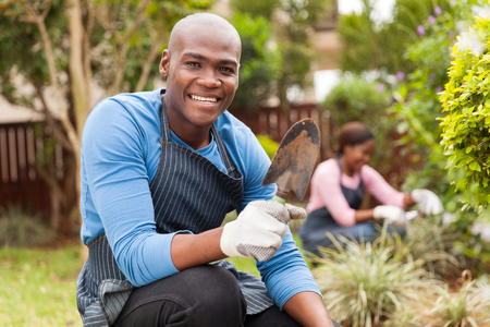 happy family nature: cheerful afro american couple gardening at home Stock Photo