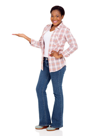 persona de pie: beautiful african american woman doing welcome gesture on white background Foto de archivo