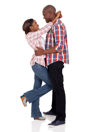 black couple: beautiful african girl hugging her boyfriend isolated on white