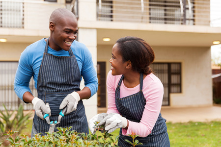 african american couple: black couple gardening in front yard