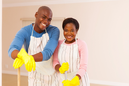black couple: happy african couple cleaning their apartment Stock Photo