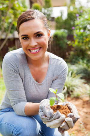 backyard woman: happy woman gardening in backyard Stock Photo