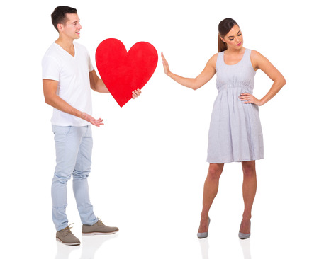 rejection sad: young man been rejected by a girl isolated on white