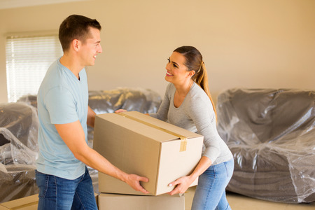 cardboard house: young couple moving into a new house