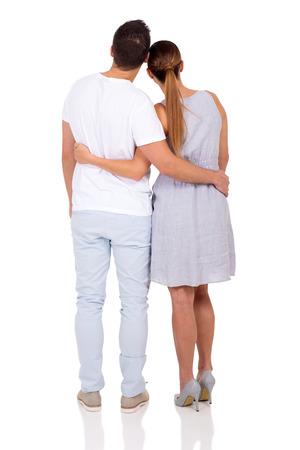 parejas enamoradas: Vista posterior de la joven pareja aislado en el fondo blanco Foto de archivo